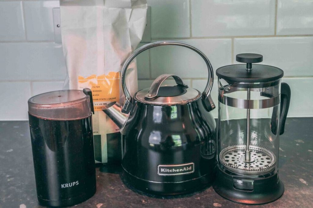 french press, kettle grinder and coffee