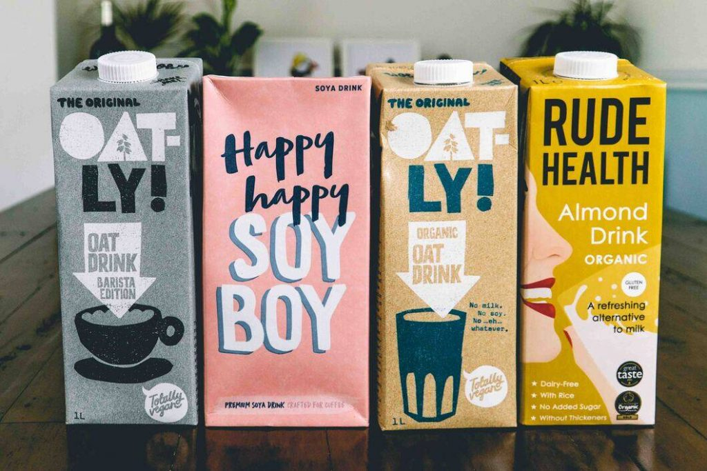 Oatly Barista, Happy Happy Soy, Organic Oatly and Rude Health Almond Milk in a line