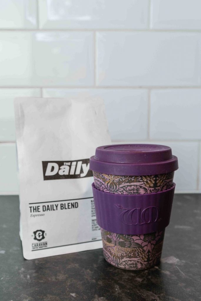 coffee cup with a lid to keep coffee warm and bag of coffee beans