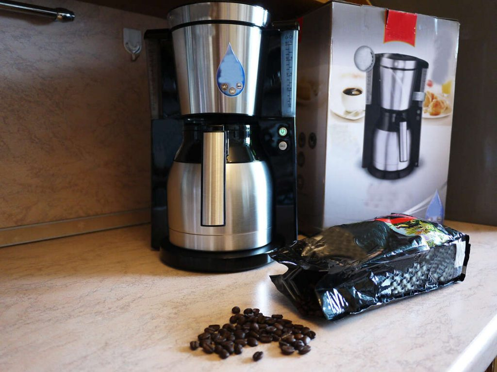 Drip Coffee Machine with bag of coffee beans