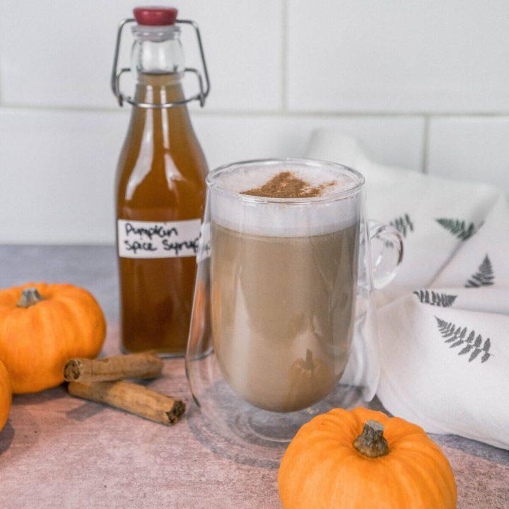Pumpkin Spice Latte with Pumpkin Syrup, cinnamon sticks and pumkin.