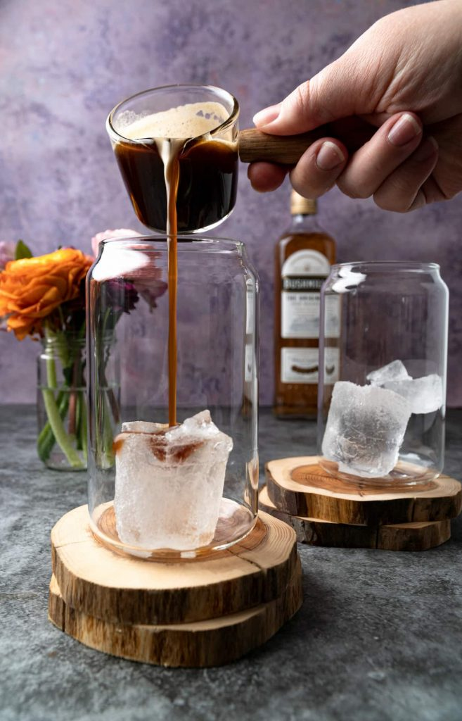 Pouring the espresso mixture on ice for Almande Baileys.