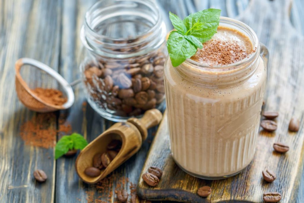 Coffee smoothie with banana in a glass jar