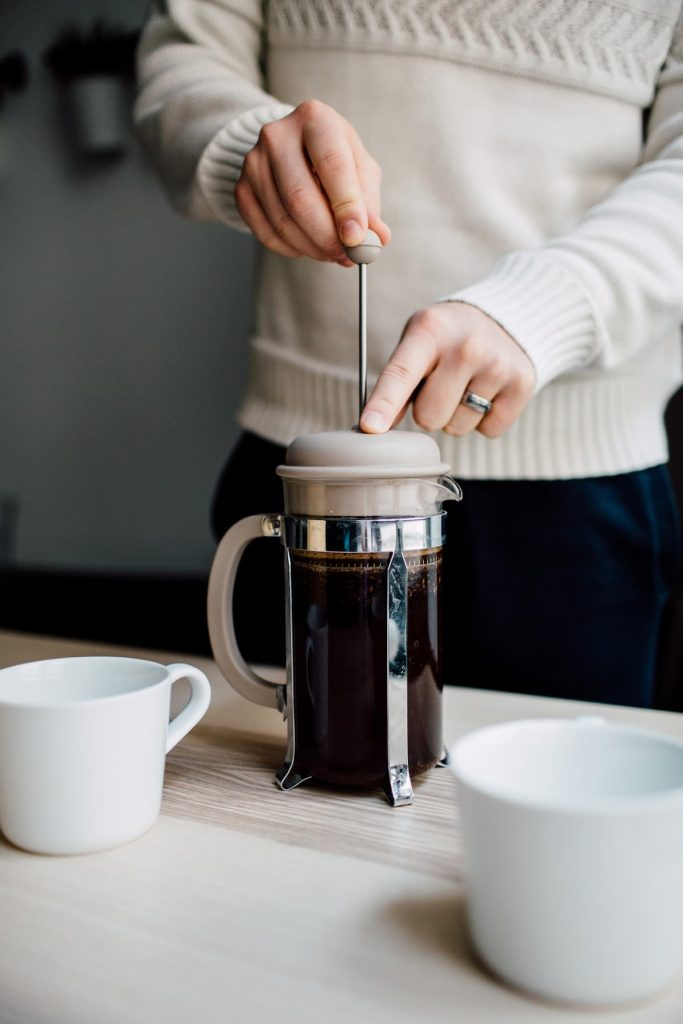 Pressing the plunger on the French press