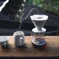 Making drip coffee at the window.