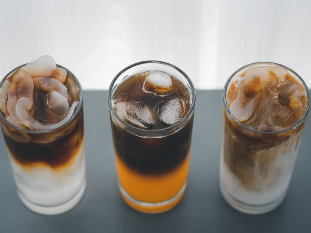 different iced coffee with toddy palm, orange, and coconut milk