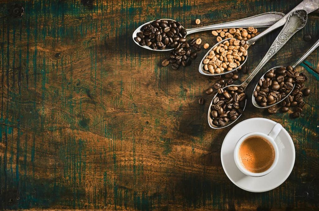 Espresso coffee with assorted roasted coffee beans