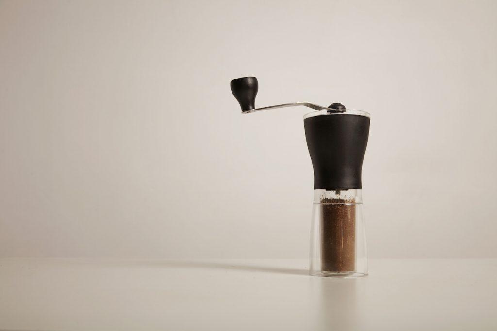 Manual grinder with freshly ground coffee