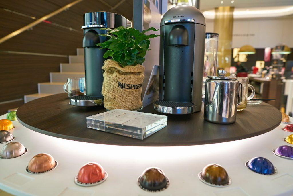 Nespresso Vertuo Machines with pods surronding it